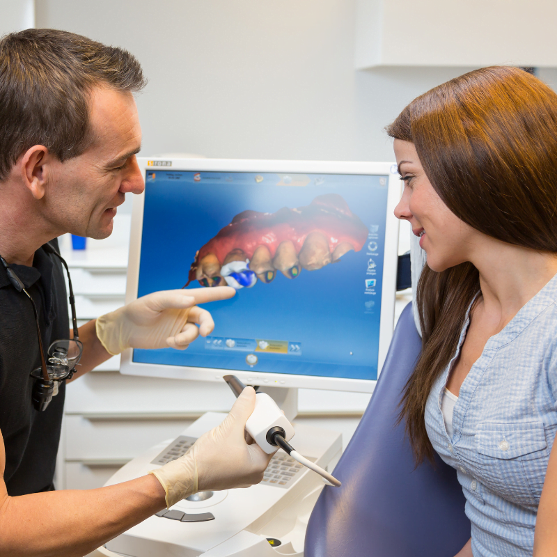 dentist discussing cerec crowns with patient