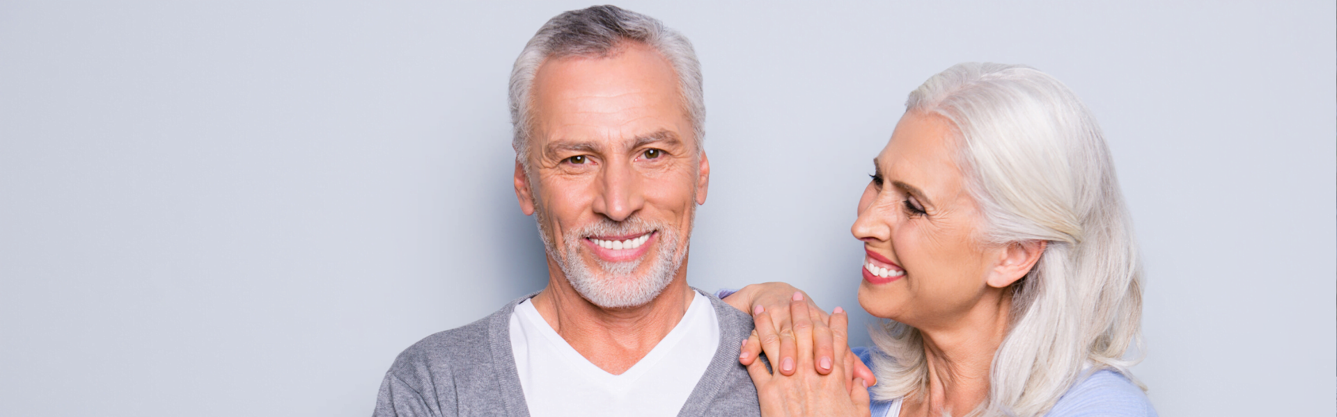 older couple smiling because they love their dental implants
