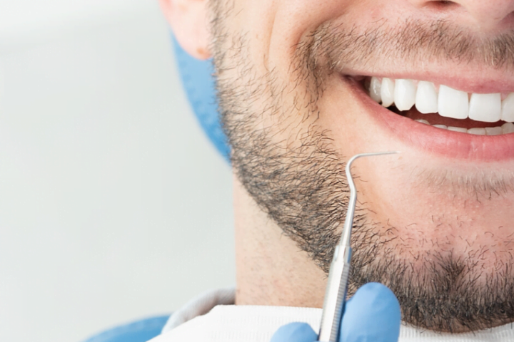 man smiling during his dental appointment